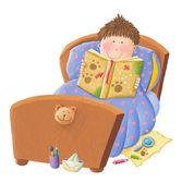 Boy reading bed time story — Φωτογραφία Αρχείου
