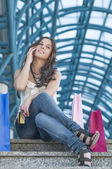 Happy shopper on the phone — Stock Photo