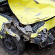 Traffic accident. Yellow crashed car — Stock Photo #40227493