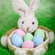 Easter basket with decorated eggs and the Easter bunny — Stock Photo #40308811