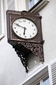 Old stylish external clock — Stock Photo