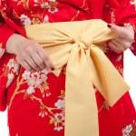 Yellow ribbon on Japanese traditional clothes of Kimono, Yukata — Stock Photo #41110473