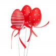 Red decorative easter eggs with ribbons, isolated — Stock Photo