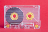 Audio cassette on red background — ストック写真