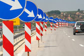 A lot of road signs showing directions  — Stock Photo