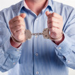 Close up of a man in handcuffs arrested — Stock Photo #42310559