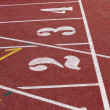 Numbers on the start of a running track — Stock Photo #42311241