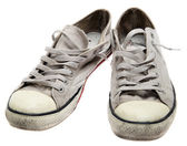 Dirty sneakers isolated on a white background — Stock Photo