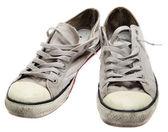 Beyaz bir arka plan üzerinde izole kirli spor ayakkabı — Stok fotoğraf