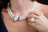 Woman with pearl necklace on her neck — Stock Photo