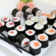 Sushi set on white plate. Traditional japanese sushi rolls — Stock Photo #43046959