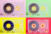 Four audio cassettes on difrent backgrounds - collage  — Stok fotoğraf