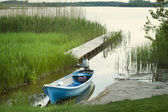 Lonely boat on the lake — Stockfoto