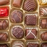 Box of various chocolate candies — Stock Photo