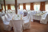 Decorated wedding tables in restaurant — Стоковое фото