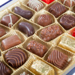 Box of various chocolate candies — Stok fotoğraf