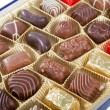 Box of various chocolate candies — Stock fotografie