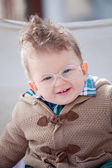 Smiling baby with eyeglasses — Stock fotografie
