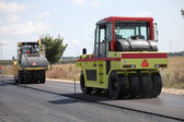 Group of heavy vibration roller compactors. Asphalting — Stock Photo