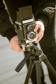 Taking pictures with old vintage camera — Stock Photo
