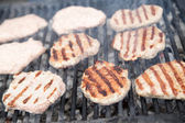 Grilling meat balls on barbecue grill — Stock Photo
