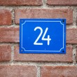 House number Twenty-four sign at old wall — Foto de Stock   #44751959