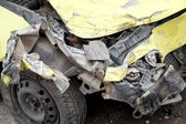 Traffic accident. Yellow crashed car — Stock Photo