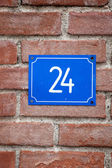 House number Twenty-four sign at old wall — Stock Photo