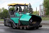 Asphalt spreading machine. Road paving construction — Stock Photo