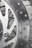 Detail of a motorcycle's disk brake — Stock Photo