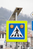 Solar powered street sign — Stock Photo
