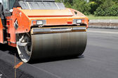 Heavy Vibration roller compactor at asphalt pavement works for road repairing — Stock Photo