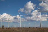 Wind turbine farm over the blue clouded sky — Stock Photo