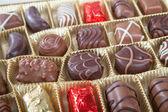 Box of various chocolate candies — Stockfoto