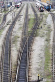 Railway tracks leading to different ways — Stock Photo