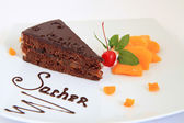 Fresh chocolate sacher cake with decoration — Stock Photo