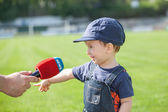 Little boy giving a interview on the field. After the match — Stock Photo