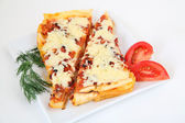 Italian lasagna with decoration on white plate — Stock Photo