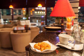Croissant and coffee cup at coffeeshop — 图库照片