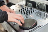 Dj mixes the track at party — Stock Photo
