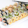 Maki sushi set on white plate. Traditional japanese sushi rolls — Stock Photo #50345807