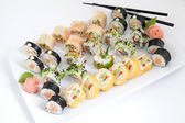 Maki sushi set on white plate. Traditional japanese sushi rolls — Foto de Stock