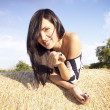 Beautiful woman laying on hay — Stock Photo