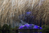 Bridge over Gauja river illuminated by firework — Stock Photo