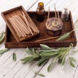 Постер, плакат: Fresh sage leaves with spa aromatherapy kit