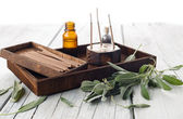 Fresh sage leaves with spa aromatherapy kit — Stock Photo