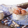 Countryside breakfast with eggs on blue kitchen towels — Stock Photo