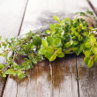 Bunch of fresh organic thyme closeup on wooden table — Stock Photo #43531751