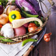 Organic healthy vegetables in the rustic basket — Stock Photo