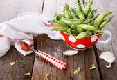 Fresh organic snow peas closeup on wooden background — Stock Photo